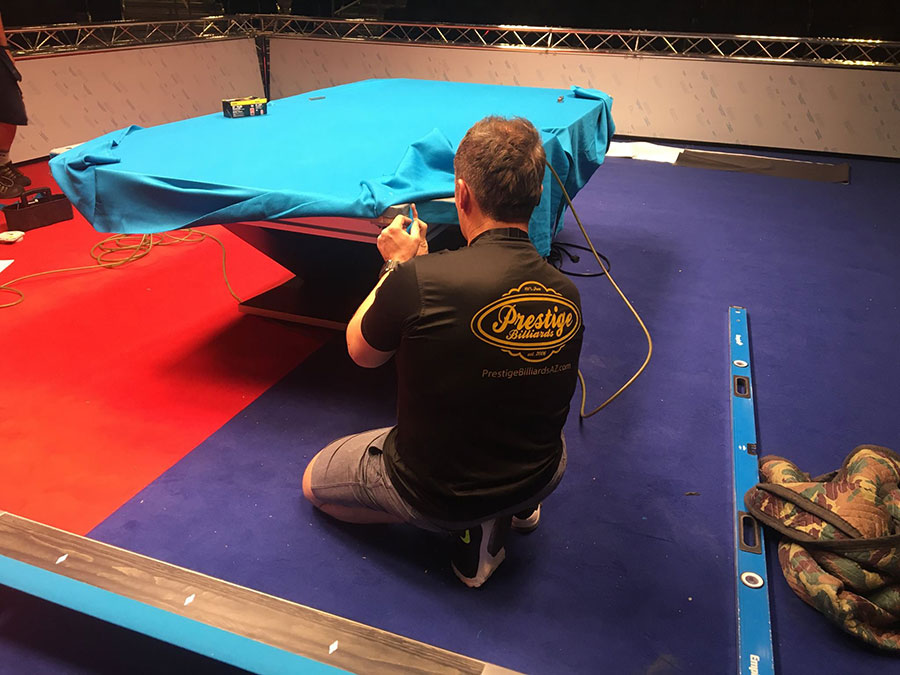 prestige-billiards-installing-new-felt-on-pool-table-for-a-tournament.jpg